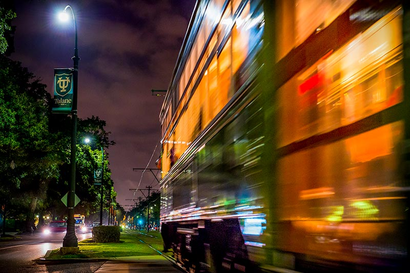 streetcar zooming down st charles at night