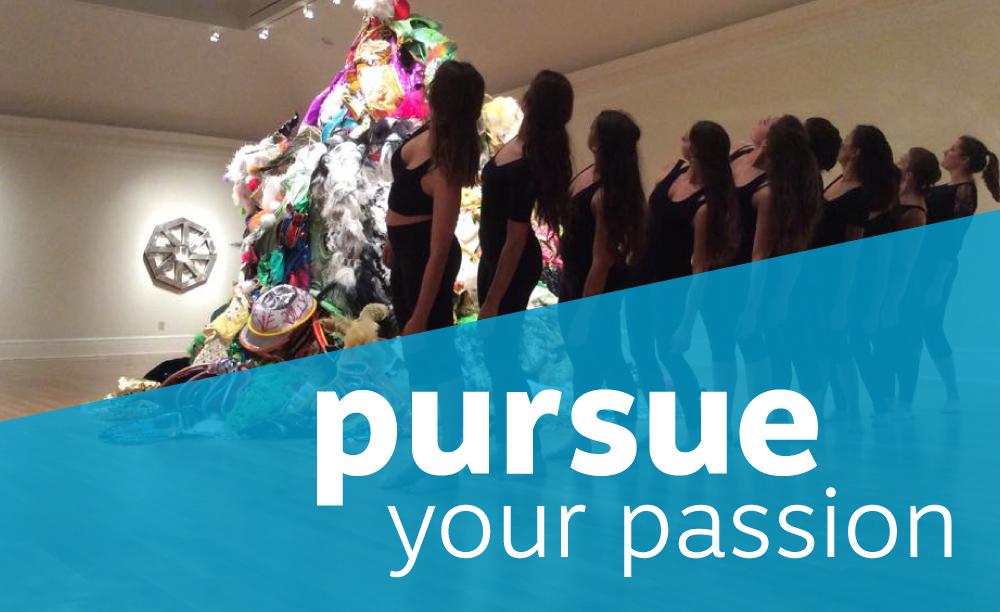 "students wearing all black look up at tall mound of fabric during a performance. Title reads ""pursue your passion"""