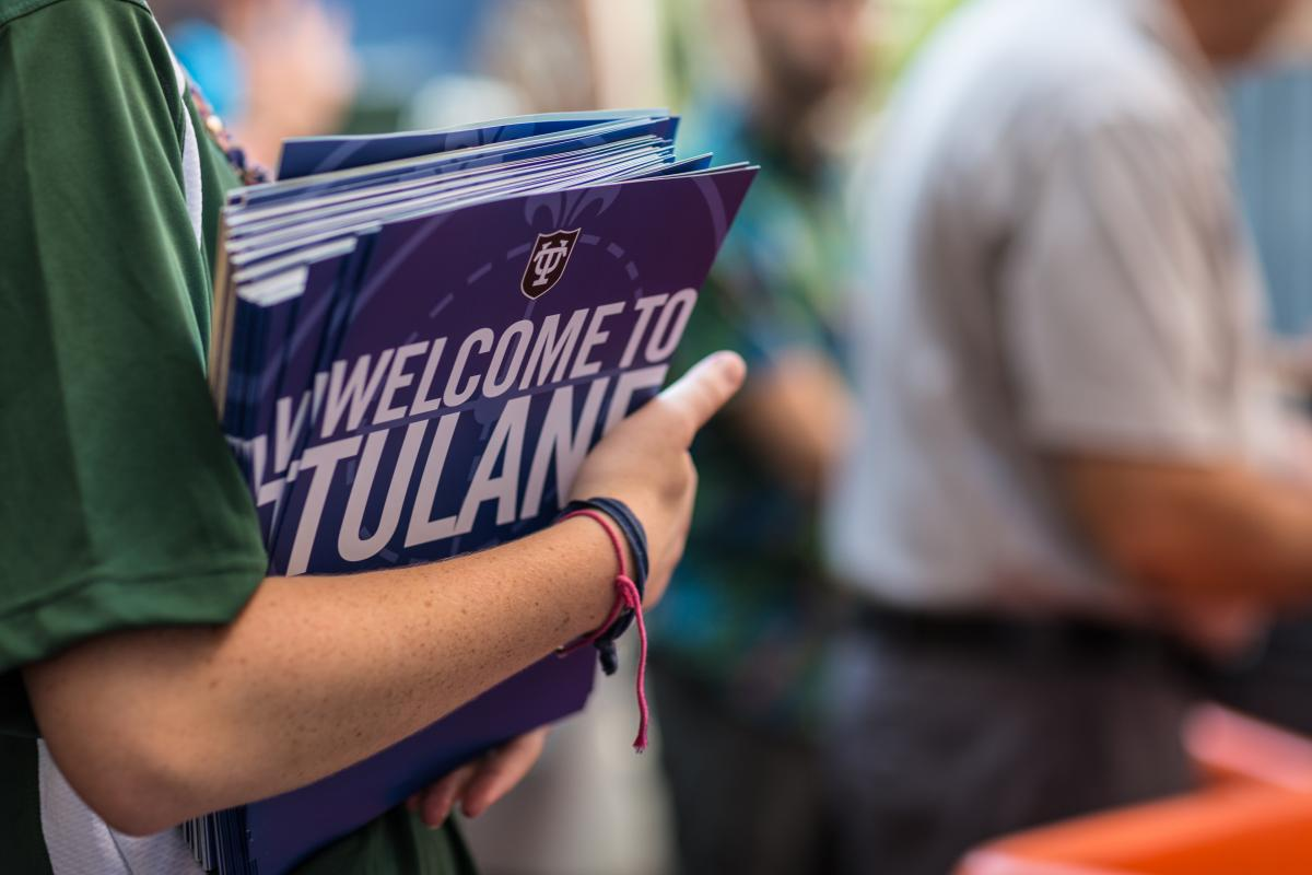 tulane student holds brochures that read 'welcome to tulane'