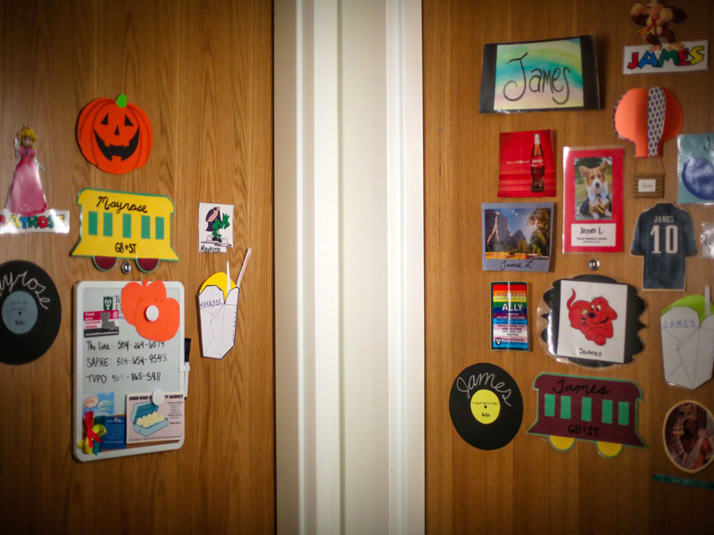 Two dorm room doors decorated with decals and stickers
